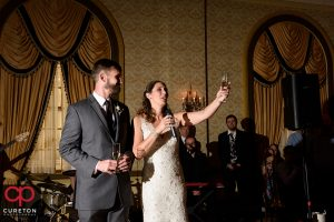 Bride raising a toast to her guests.