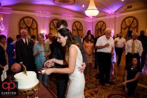 Briding groom cutting the cake.