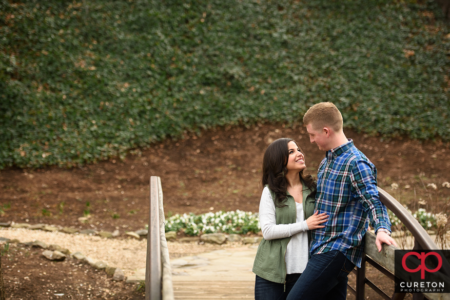 Couple standing on a bridge in falls park.