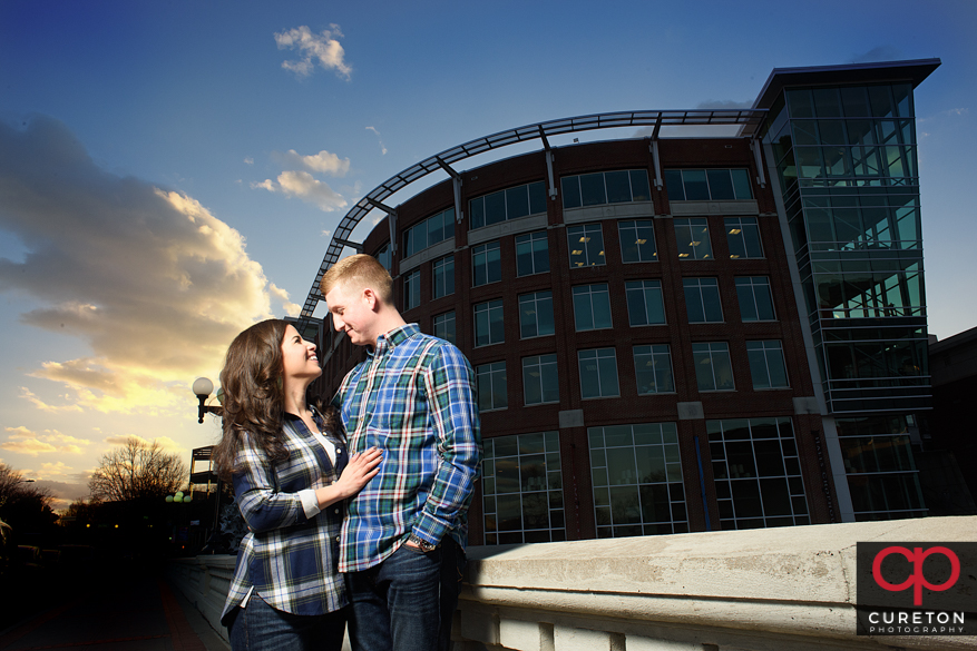 Engagement session finale with a beautiful winter sunset outside of falls park in downtown Greenville,SC.