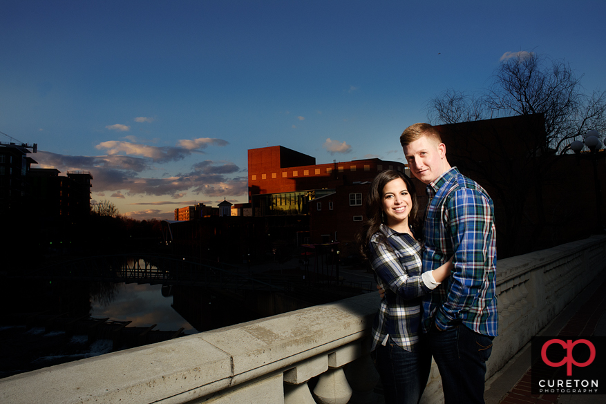 Engaged couple walking in downtown Greenville,SC.