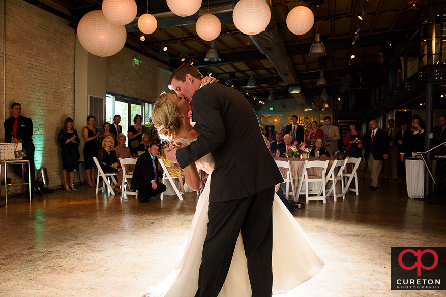 Groom dips the bride during their first dance.