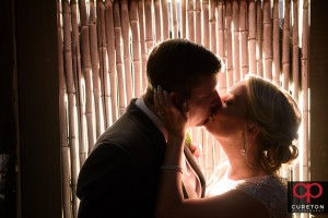 Bride and Groom kissing outside of a wedding reception at Zen in downtown Greenville,SC.